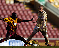 Photo: Jed Wee.<br />Bradford City v Bristol City. Coca Cola League 1. 18/02/2006.<br />Bristol's Dave Cotterill (R) is tackled by Bradford's Damion Stewart.