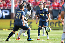 July 28, 2018 - Ann Arbor, Michigan, United States - Andreas Pereira (15) and Ander Herrerra (21) of Manchester United vie for control of the ball under the pressure of  Sadio Mane (10) of Liverpool during an International Champions Cup match between Manchester United and Liverpool at Michigan Stadium in Ann Arbor, Michigan USA, on Wednesday, July 28,  2018. (Credit Image: © Amy Lemus/NurPhoto via ZUMA Press)