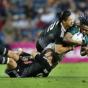 Rugby Sevens . Men. Gold Medal  Match .  New Zealand v South Africa.  Seabelo Senatla is tackled by by Sherwin Stowers (on ground) and Ben Lam.