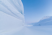 View up windswept snow banks in Foxdalen, Svalbard.