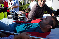 © under license to London News Pictures. 19/02/2011. Injured protesters arrive at Salmaniya Hospital Complex after being fired upon by police during a march to Pearl Roundabout in Manama, Bahrain today (19/02/2011). Thousands of people have returned to Bahrain's Pearl roundabout after both the army and the police leave the anti-government protest site. Photo credit should read Michael Graae/London News Pictures