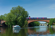 First Great WesternTrain on Brunel Sounding Arch Railway Bridge over River Thames at Maidenhead, Berkshire, UK