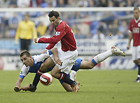 Photo: Aidan Ellis.<br /> Wigan Athletic v Manchester United. The Barclays Premiership. 14/10/2006.<br /> United's Ryan Giggs gets the better of Wigan's Paul Scharner