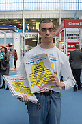 A young man handing out The New York Review paper during day three of the London Book Fair on the 14th March 2019 at London Olympia in the United Kingdom.