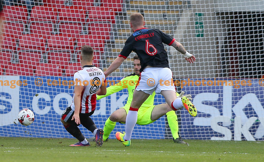 Billy Waters of Cheltenham scores during the Sky Bet League 2 match between Cheltenham Town and Crawley Town at the Abbey Business Stadium in Cheltenham. October 15, 2016.<br /> James Boardman / Telephoto Images<br /> +44 7967 642437