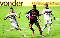 SAO PAULO, BRAZIL - FEBRUARY 25: Gerson of CR Flamengo competes for the ball with Welington and Luciano of Sao Paulo FC ,during the Brasileirao Serie A 2020 match between Sao Paulo FC and CR Flamengo at Morumbi Stadium on February 25, 2021 in Sao Paulo, Brazil. (Photo by MB Media/BPA)