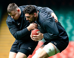 Cory Hill of Wales with team-mate Rob Evans of Wales<br /> <br /> Photographer Simon King/Replay Images<br /> <br /> Six Nations Round 3 - Captains Run - Wales v England - Saturday 22nd February 2019 - Principality Stadium - Cardiff<br /> <br /> World Copyright © Replay Images . All rights reserved. info@replayimages.co.uk - http://replayimages.co.uk