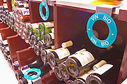 Bottles on display with special round markers for Vin Bio, organically biodynamic grown wines, in the foreground Domaine Clos du Tue-Boeuf, in Cheverny, the Loire Valley The Lavinia wine shop in Paris. Probably the biggest wine shop in Paris, with its special temperature controlled section for wines that are fragile and must be stored at cool low temperature.