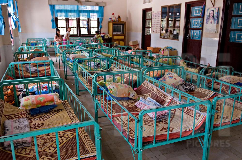 Raw of empty bed in catholic orphanage of Kontum, Vietnam, Asia
