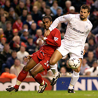 Photo. Jed Wee.<br /> Liverpool v Bolton Wanderers, FA Barclaycard Premiership, Anfield, Liverpool. 26/12/2003.<br /> Bolton's Emerson Thome (R) uses his strength to hold off Liverpool's Florent Sinama-Pongolle.
