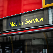 "A London bus displays a ""not in service"" sign in central London."