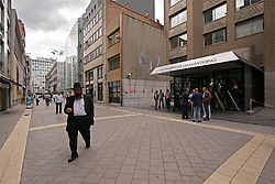 Pedestrians and diamond dealers walk past the Antwerpsche Diamantkring on Hoveniersstraat, in the heart of the diamond district, in Antwerp, Belgium, on Wednesday August 26, 2009. (Photo © Jock Fistick)