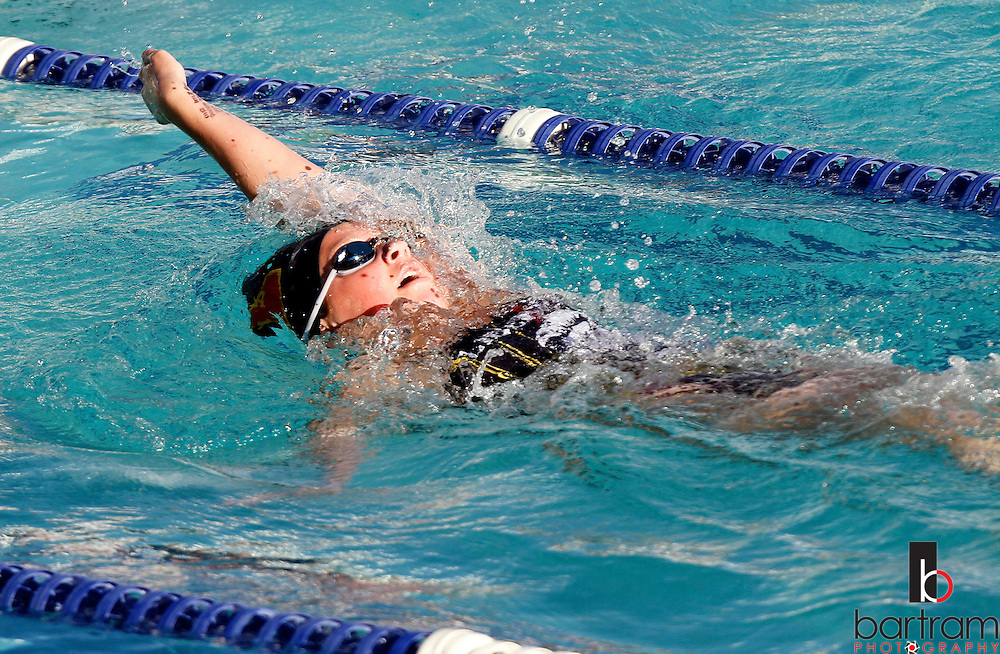 Liberty High School swimmer Rosie Doria competes in the 100 Meter Backstroke against Deer Valley during a meet at Deer Valley High School on Friday, April 20, 2012. (Photo by Kevin Bartram)