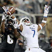 ORLANDO, FL - OCTOBER 03:  TieNeal Martin #7 of the Tulsa Golden Hurricane breaks up a pass to Marlon Williams #6 of the Central Florida Knights at Bright House Networks Stadium on October 3, 2020 in Orlando, Florida. (Photo by Alex Menendez/Getty Images) *** Local Caption *** TieNeal Martin; Marlon Williams