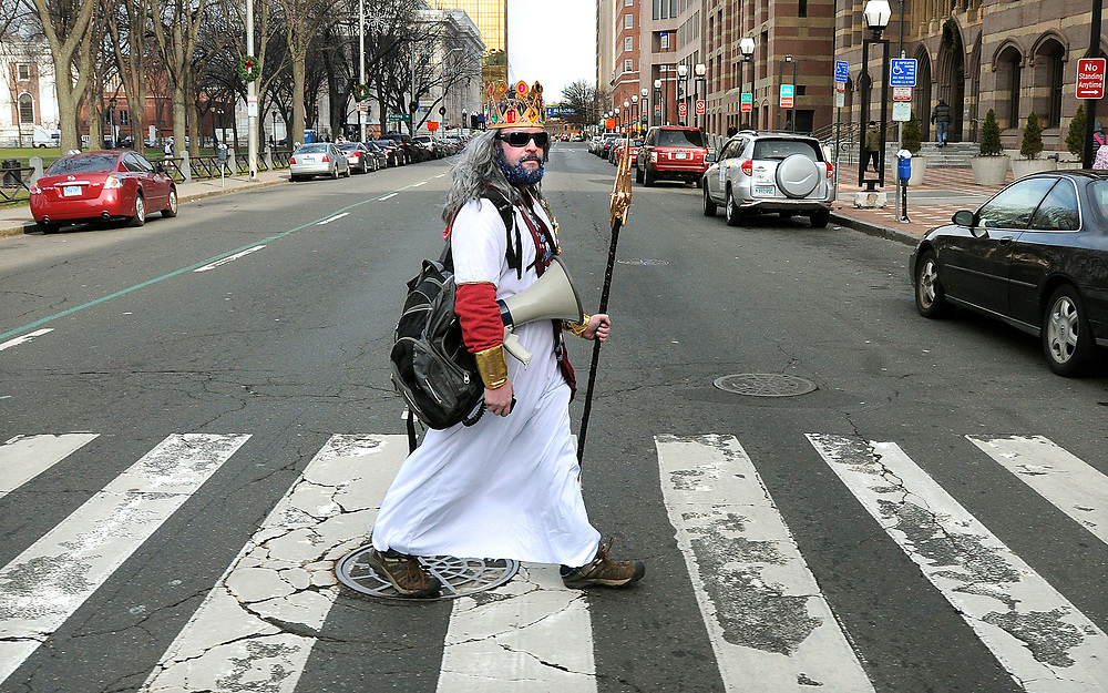 Chris Randall, executive director of the New Haven Land Trust dressed as Poseidon outside New Haven City Hall to encourage folks to attend the annual Polar Plunge for New Haven Parks and Community Gardens held Jan. 1 at Lighthouse Park in New Haven 11am - 3pm. Photo by Mara Lavitt/New Haven Register<br /> <br /> 12/30/11