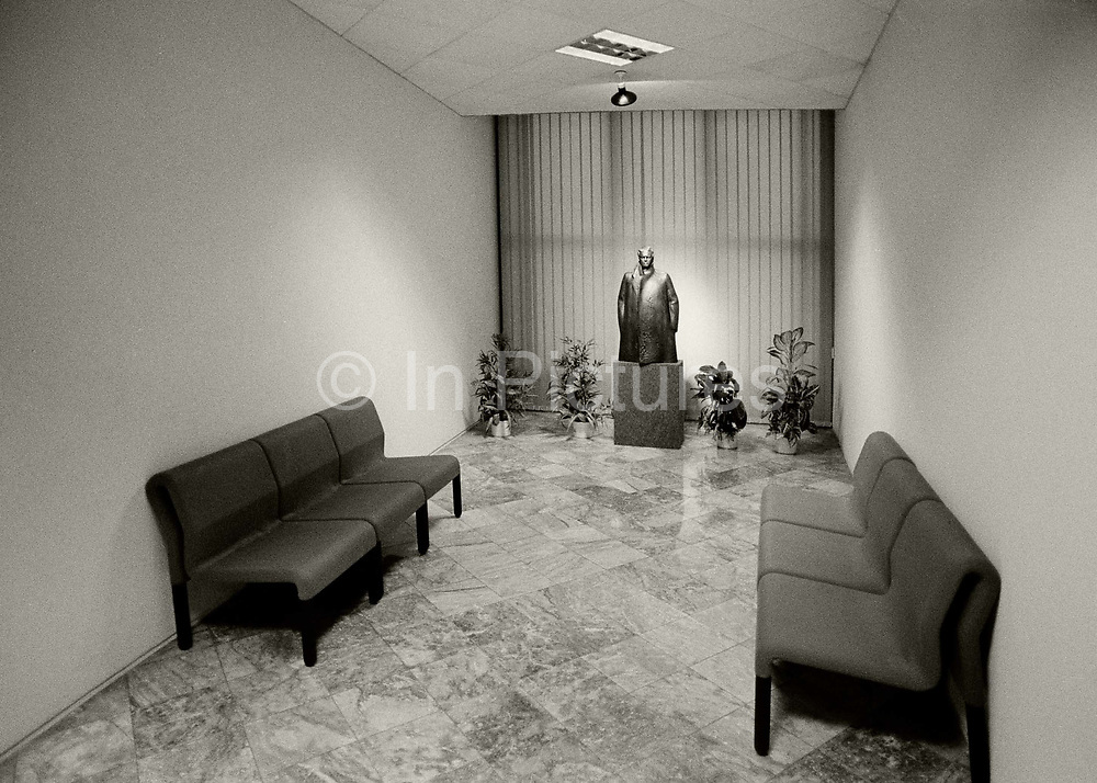 """Small statue of Enver Hoxha in a waiting room inside the Pyramid,  Tirana. This brutal structure was designed by the daughter and son-in-law of Enver Hoxha, Albania's communist dictator. Initially, it was a mausoleum (officially the """"Enver Hoxha Memorial Museum""""), inaugurated in 1988 as the final resting place of Albania's ruler, Enver Hoxha, the lord of life and death in Albania from 1944 until his death in 1985.<br /> <br /> With the fall of the Communist regime in 1991, Hoxha's corpse was evicted, just three years into its final rest. In 1992, the Pyramid became in name Tirana's main cultural center devoted to promoting contemporary arts (visual and performing arts, music, film and culture). In reality, its various halls were better known for the hosting of consumer goods trade fairs."""