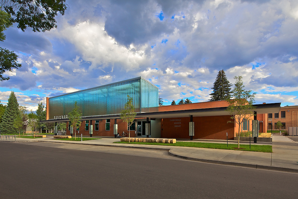The Carbondale Branch Library. I choose my angle to accentuate the horizontal lines of the glass canopy. I waited for the light to just graze the street side. The light entering the end of the canopy naturally illuminates the interior.