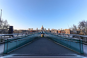London Millenium foot-Bridge is seen nearly empty during rush hour as commuters work from home due to the coronavirus pandemic. Sunday, March 22, 2020. The British government is encouraging people to practice social distancing to help prohibit the spread of Coronavirus, further restrictions may be imposed if the public does not adhere to their advice. For most people, the new coronavirus causes only mild or moderate symptoms, such as fever and cough. For some, especially older adults and people with existing health problems, it can cause more severe illness, including pneumonia. (Photo/Vudi Xhymshiti)