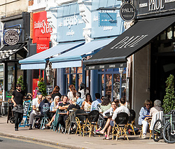 "© Licensed to London News Pictures. 12/09/2020. Surrey, UK. Groups of people enjoy a coffee and cake in the sunshine in Wimbledon Village in South West London this afternoon before the ""Rule of 6"" comes into force on Monday as weather experts announce a 6 day mini heatwave in the South East of England this week with highs in excess of 29c. Prime Minister Boris Johnson is already under pressure after he announced on Friday that gatherings of more than six people will be banned from Monday in the hope of reducing the coronavirus R number. The Rule of Six as it is known, has already become unpopular with MPs and large families. Photo credit: Alex Lentati/LNP"