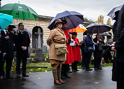 © Licensed to London News Pictures. 07/11/2018. London, UK. Chelsea Pensioners and WW1 re-enactors shelter from the rain during a ceremony at Brompton Cemetery as a plaque is unveiled as a memorial to all Royal Parks gardens and grounds staff who died in WW1. Photo credit: Rob Pinney/LNP