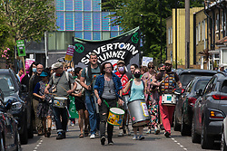 London, UK. 5th June, 2021. Environmental activists and local residents protest against the construction of the Silvertown Tunnel. Campaigners opposed to the controversial new £2bn road link across the River Thames from the Tidal Basin Roundabout in Silvertown to Greenwich Peninsula argue that it is incompatible with the UK's climate change commitments because it will attract more traffic and so also increased congestion and air pollution to London's most polluted borough.
