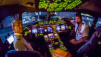 Pilots in the cockpit prepare the Delta Airlines Boeing 777-200LR  for the 17 hour flight from Atlanta, Georgia to Johannesburg, South Africa (the second longest nonstop flight in the world).