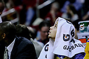 March 23, 2011; Houston, TX, USA; Golden State Warriors point guard Stephen Curry (30) watches the game against the Houston Rockets from the bench during the second quarter at the Toyota Center. Mandatory Credit: Thomas Campbell-US Presswire