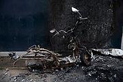 Vehicle crime. Stolen burnt out scooter left on the pavement in London, UK.