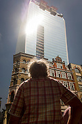 Londoners experience the unexpected intensity of localised solar rays, reflected off the concave plate glass windows of one of the capital's newest skyscrapers known as the Walkie-talkie. The hotspot has surprised developers and passers-by below and which has already melted a parked car and left soft street fittings smouldering in Eastcheap Street, City of London, the capital's financial district. One thermometer placed in the street reached 144F (62 celsius) and others off the scale and city workers poured out of their offices at lunchtime to witness the strange phenomena of intense, Biblical light and blistering heat.