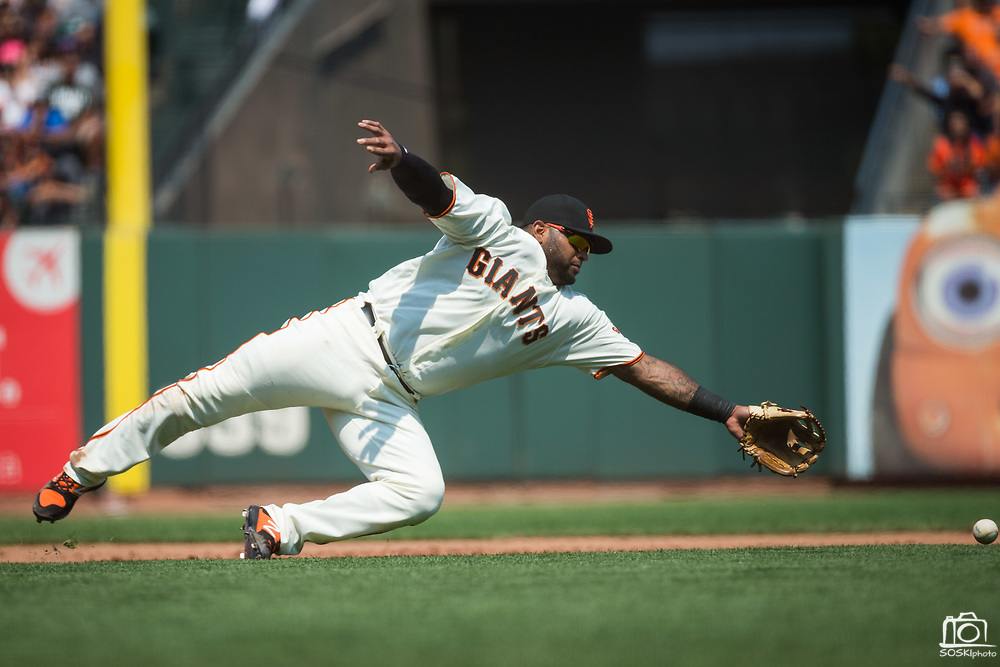 San Francisco Giants third baseman Pablo Sandoval (48) dives for a ground ball against the Philadelphia Phillies at AT&T Park in San Francisco, California, on August 20, 2017. (Stan Olszewski/Special to S.F. Examiner)
