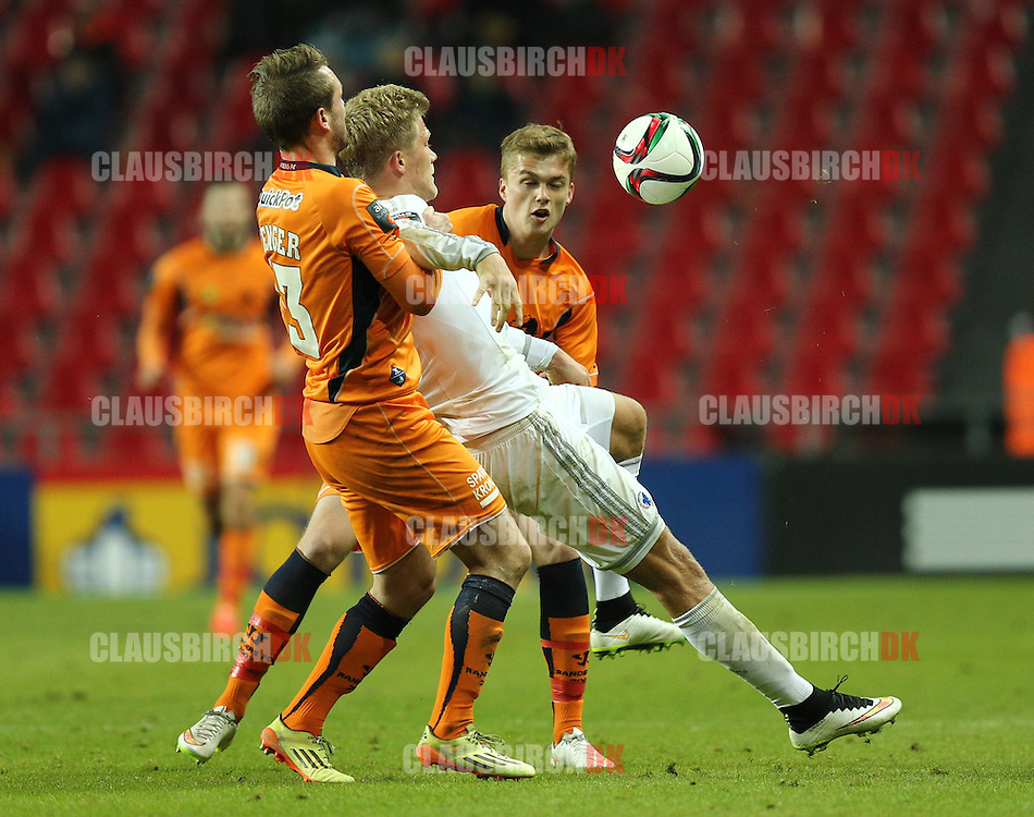 Andreas Cornelius of FC København is fouled by Mads Fenger of Randers FC during the Danish DBU Pokalen Cup match between FC København and Randers FC at Telia Parken on March 5, 2015 in Copenhagen, Denmark. (Photo by Claus Birch)