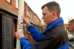 Council Housing Management staff putting up a notice about dog fouling. North Tyneside Council. UK