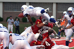 All American Linebacker Boomer Grisby(46) of Illinois State can only get a hand full of knee and Cavari Dailey(4) can only duck when Jonathan Taylor (5) of Drake takes it to the end zone over the top during action at Hancock Stadium in Normal on August 28, 2003