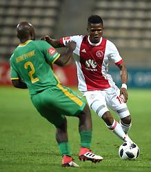 Cape Town-180424Ajax Cape Town midfielder Rodrck Kabwe by Baroka defender Matome Kgoetyane In a PSL game at   at Athlone stadium.photographer:Phando Jikelo/African News Agency/ANA