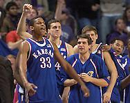 C. J. Giles (33) and his Kansas teammates celebrate as they beat Kansas State 66-52 at Bramlage Coliseum in Manhattan, Kansas, March 4, 2006.