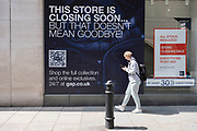 Sign for the American clothing company GAP advising shoppers that although the store is closing, the company will remain trading online on 10th August 2021 in London, United Kingdom. The US fashion store Gap has confirmed it plans to close all of its 81 stores in the UK and Ireland to go online-only from Autumn.