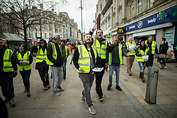 "© Licensed to London News Pictures . 09/02/2019. Manchester , UK . JAMES GODDARD (c) leads a "" Yellow Vest "" protest in Manchester City Centre . The yellow vest concept has been adopted from French demonstrators by some British groups in support of Brexit , Donald Trump and former EDL leader Stephen Yaxley-Lennon - aka Tommy Robinson . A similar demonstration in the city in January was ridiculed after protesters were kettled by police in front of a branch of Greggs the Baker . Photo credit : Joel Goodman/LNP"