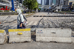 May 23, 2019 - Central Jakarta, Jakarta, Indonesia - Jakarta, Indonesia, 23 May 2019 : After Riots from Dusk Till Dawn on 22 May 2019 in front Indonesia Election Supervisory Agency, condition at the location look calm as the street still closed for public to prevent another action which according to the police will held untill 25 May 2019. But untill afternoon the situation look calm and under control, many people hope that PRABOWO Supporter will held another action as they think what those anarchist done just not reasonable and childish. (Credit Image: © Donal Husni/ZUMA Wire)