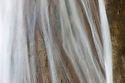 This close-up shows the texture of the steep rock wall behind Lower Twin Falls near North Bend, Washington. The entire waterfall drops 135 feet (41 meters).