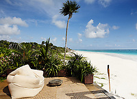 with bean bag chair a view of the beautiful white sand beach of tulum in yucatan mexico