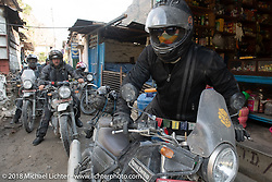 Chris Shelby on the main street of Tatopani starting out on Day-7 of our Himalayan Heroes adventure riding from Tatopani to Pokhara, Nepal. Monday, November 12, 2018. Photography ©2018 Michael Lichter.