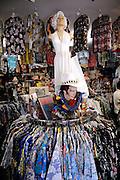 "Marilyn Monroe statue and Elvis bust amongst Hawaiian shirts (aka ""aloha shirts"") for sale at Bailey's Antiques and Aloha Shirts store in Honolulu, Hawaii"