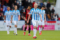 Huddersfield Town's Aaron Mooy leaves the pitch at half time during the Premier League match at the John Smith's Stadium, Huddersfield.