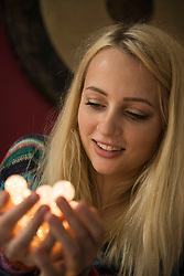 Young woman looking at fairy lights, Bavaria, Germany