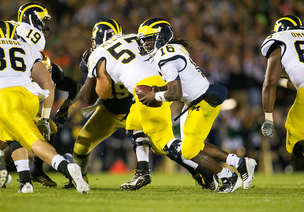 September 22, 2012:  Michigan quarterback Denard Robinson (16) fakes he handoff during NCAA Football game action between the Notre Dame Fighting Irish and the Michigan Wolverines at Notre Dame Stadium in South Bend, Indiana.  Notre Dame defeated Michigan 13-6.