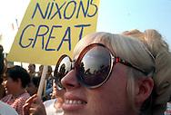 .A Nixon fan watches Richard     Nixon during a campaiign  speech in September 1968...Photo by Dennis Brack  B 10