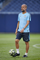 """July 19, 2018 - Chicago, IL, U.S. - CHICAGO, IL - JULY 19: Manchester City head coach Josep """"Pep"""" Guardiola looks on during Manchester City's practice session ahead of the International Champions Cup match between Manchester City and Borussia Dortmund on July 19, 2018 held at Soldier Field in Chicago, Illinois. (Photo by Robin Alam/Icon Sportswire) (Credit Image: © Robin Alam/Icon SMI via ZUMA Press)"""