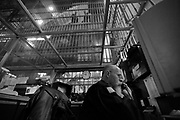 Officer Doug Rankin speaks on the phone in the central control room with a glass ceiling as inmates look down from above.  The Bristol County Jail & House of Correction located on Ash Street in New Bedford, Massachusetts was started in 1829, and is the oldest running jail in the United States.   The Ash street jail, as it is known, has been a controversial facility since it opened.  It is believed to be the site of the last pubic hanging in Massachusetts sometime in the 1890's.  Two big riots broke out in the 90's (1993, 1998) and since then the facility has been modified to alleviate some of the crowded conditions that resulted in the riots.