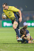 Todd Clever (L) of USA tries to stop Daniel Carpo (L) of Romania during their  rugby test match between Romania and USA, on National Stadium Arc de Triomphe in Bucharest, November 8, 2014.  Romania lose the match against USA, final score 17-27.