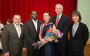 L-R: Dr. Steven Shetzer, Santel Frazier, Claire Frazier, Michael Lunceford and Sylvie Christophe poses for a photograph after Claire Frazier was awarded the Chevalier dans Ordre des Palmes Academiques by France Cultural Attache Sylvie Christophe at Kolter Elementary School, November 20, 2013.